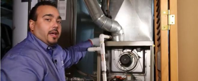 Sears technician performs preventive maintenance check on furnace
