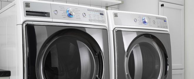front load washer and dryer in laundry room