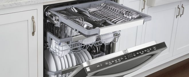 Photo of an open Kenmore dishwasher in white modern kitchen