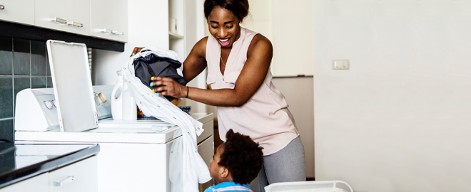 Mom and son do laundry together