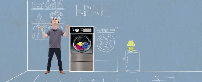 Man stands exasperated by washer that won't start