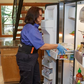 Sears Home Services local refrigerator repair technician fixes a refrigerator near me