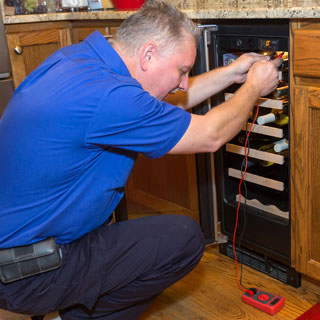 Sears Home Services refrigerator repair technician near me servicing a wine refrigerator